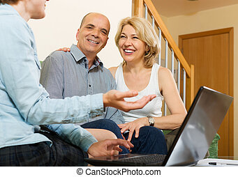 Senior couple answer questions of social worker
