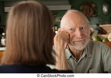 Senior couple at home focusing on angry man - Senior couple...