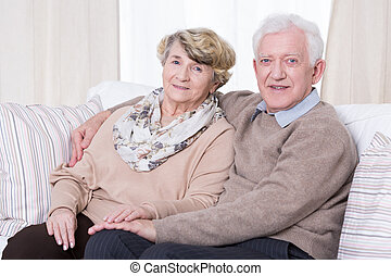 Senior couple at home - Portrait of happy senior couple at...