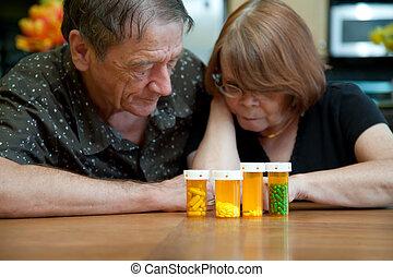 Senior Couple at Home Reading Prescription Labels