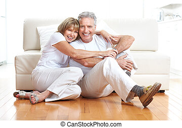 Senior couple at home smiling and happy