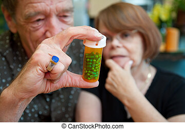 Senior Couple at Home with Perscription