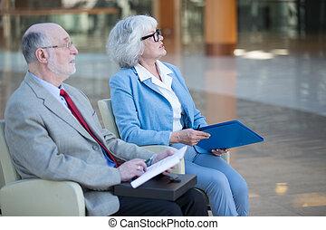 Senior couple at meeting