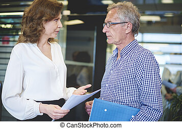 Senior couple business with documents