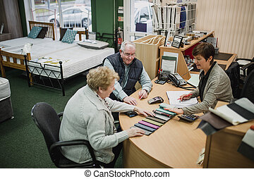 Senior Couple Buying a New Bed