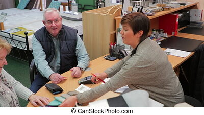 Senior Couple Buying a New Bed - Senior couple are buying a ...