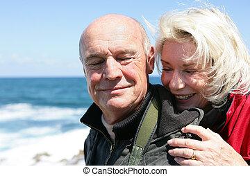 Senior couple by the coast
