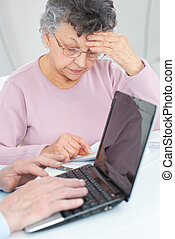 senior couple calculating taxes at home