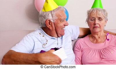 Senior couple celebrating a birthda
