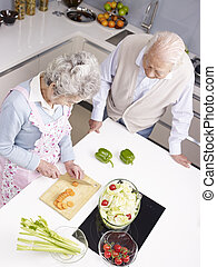 senior couple chatting in kitchen