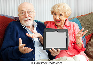 Senior Couple Confused by Tablet PC - Confused senior couple...