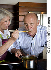 Senior couple cooking together