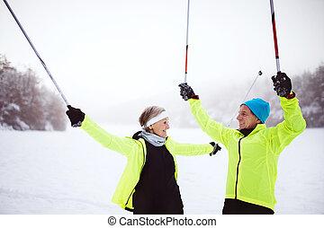 Senior couple cross-country skiing.