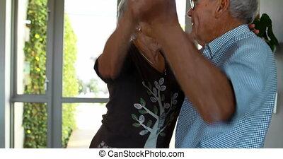 Senior couple dancing at home 4k