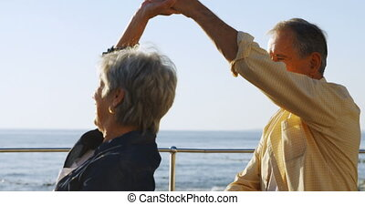 Senior couple dancing at promenade near sea side 4k - Senior...
