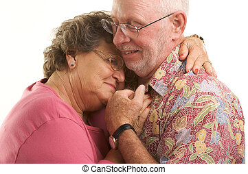 Happy Senior Couple romantically dancing.