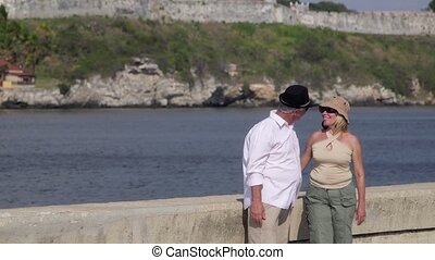 Senior couple dancing, kissing - Old people traveling, ...
