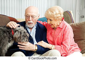 Senior Couple - Dog Lovers - Senior couple at home with...