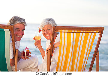 Senior couple drinking a cocktail