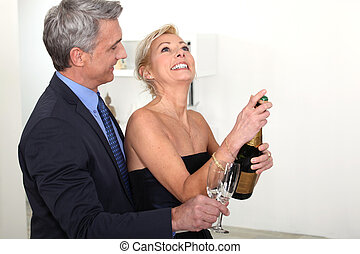 Senior couple drinking champagne