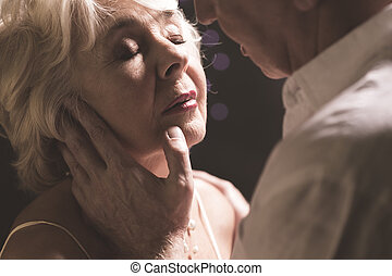 Senior couple during intimate moments - Close-up of senior...