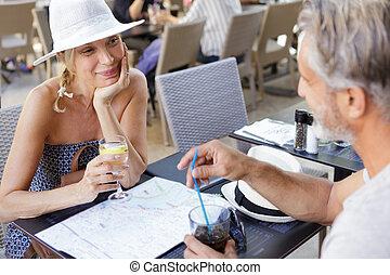 senior couple enjoying a drink in a bar