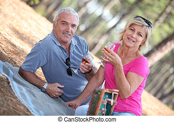 Senior couple enjoying romantic picnic