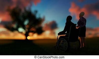 Senior couple enjoying sunrise on green meadow with oak...