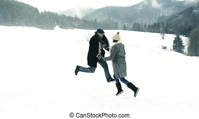 Senior couple enjoying themselves in winter nature.