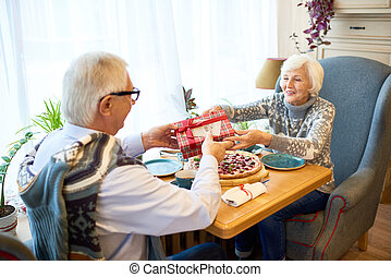 Senior Couple Exchanging Gifts
