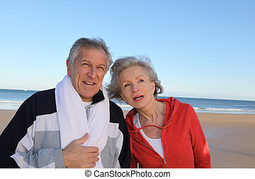 Senior couple exercising by the sea