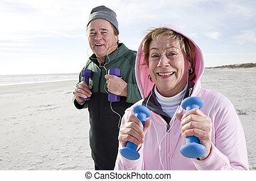 Senior couple exercising on beach