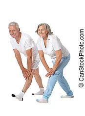 Senior couple exercising - Portrait of senior couple...