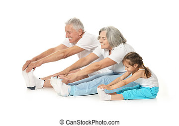 Senior couple exercising with granddaughter isolated on ...
