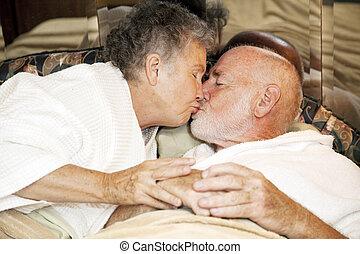 Senior Couple Goodnight Kiss
