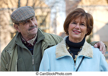 Senior Couple - Happy senior couple look at the camera....