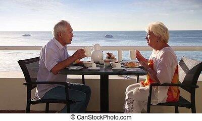 Senior couple have breakfast