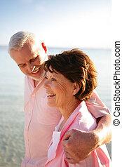 Senior couple having a walk by the seaside