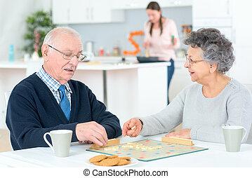 senior couple having breakfast at home