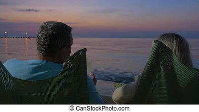 Senior couple having cocktails on summer resort