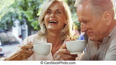 Senior couple having coffee in cafe 4k
