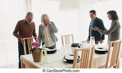 Senior couple having dinner with friends at home. - Happy...
