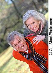 Senior couple having fun in countryside