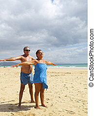 Senior Couple having fun in the beach