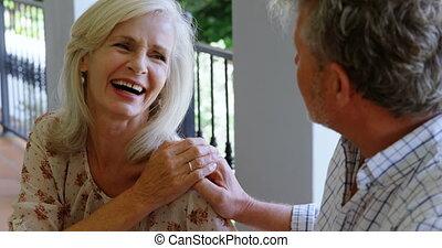 Senior couple having fun in the porch 4k - Senior couple...