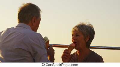 Senior couple having ice cream at promenade 4k - Senior...