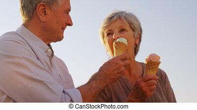 Senior couple having ice cream at promenade 4k - Senior...