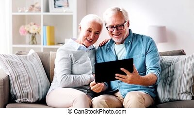 senior couple having video call on tablet computer - family,...
