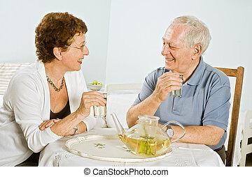 senior couple herbal tea