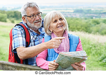 Senior Couple Hiking In Countryside